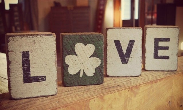 Decorate your home with painted blocks for your St Patrick's Day celebration in white and green colours with a shamrock throwni in for good measure