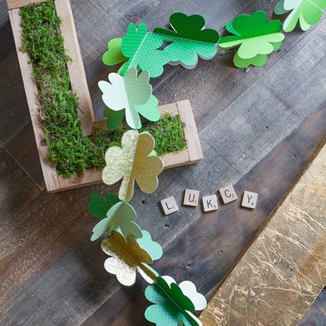 Decorate your home with this paper shamrock garland for St Patrick's Day- check out the free template