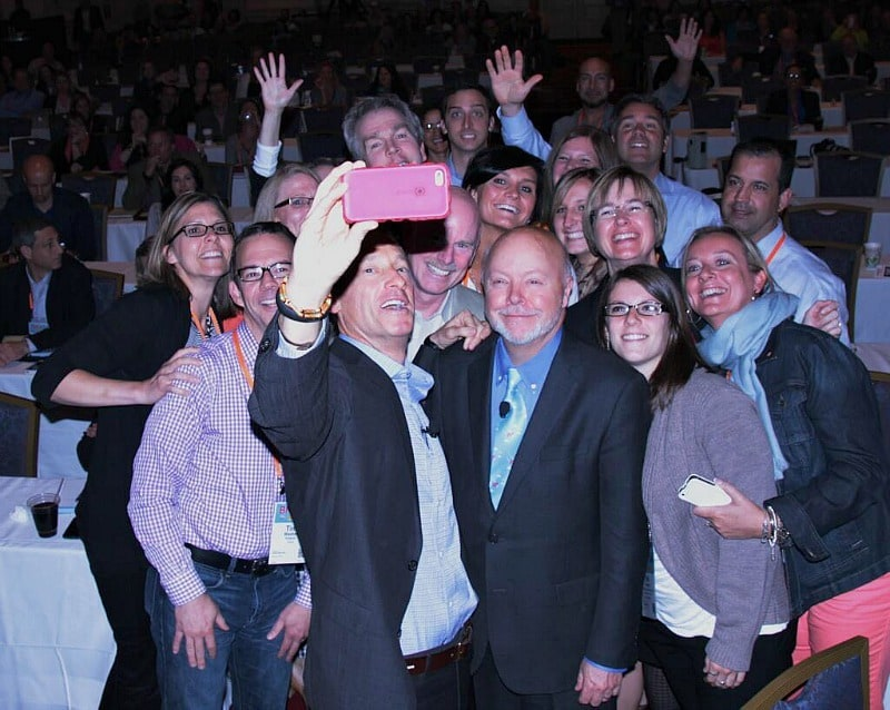 David Meerman Scott takes a selfie when delivering his B2B marketing keynote about marketing the moon