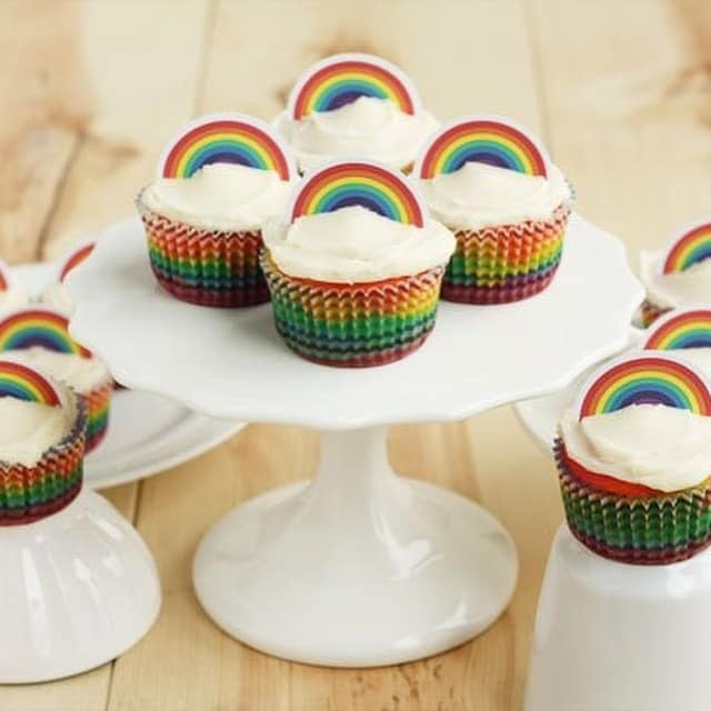 Recipe for rainbow cupcakes and decorated with a free printable rainbow cupcake topper